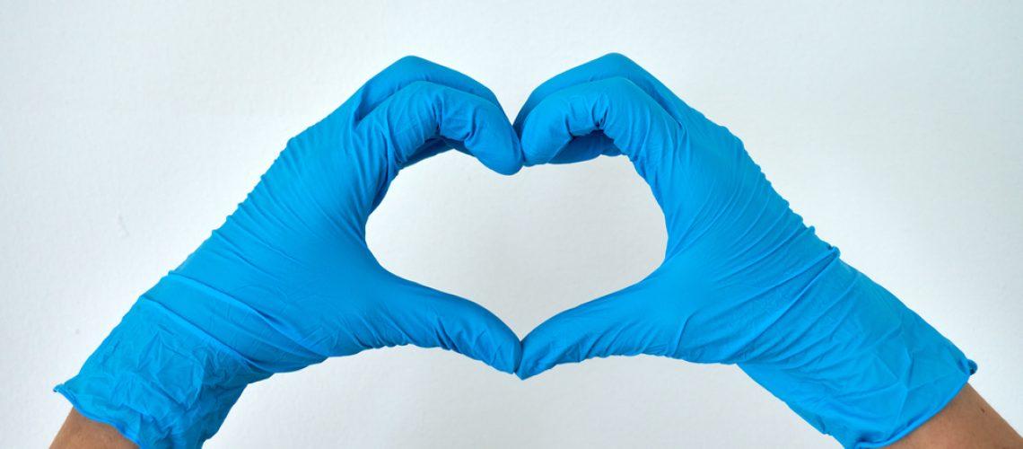 Human,Rising,Hands,Make,Finger,Heart,Shape,Wearing,Blue,Disposable