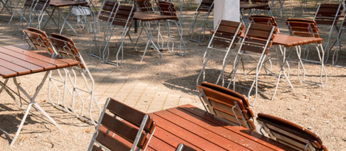 Empty,Chairs,And,Tables,Folded,Up,In,A,Beer,Garden